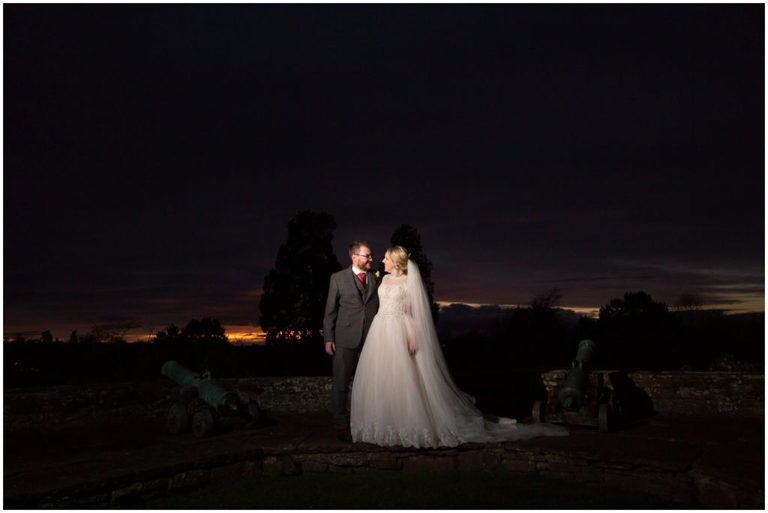 bride and groom sunset at Berkeley Castle Gloucestershire
