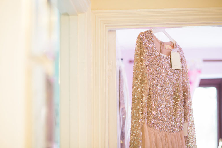 bridesmaid dress hanging on a door frame