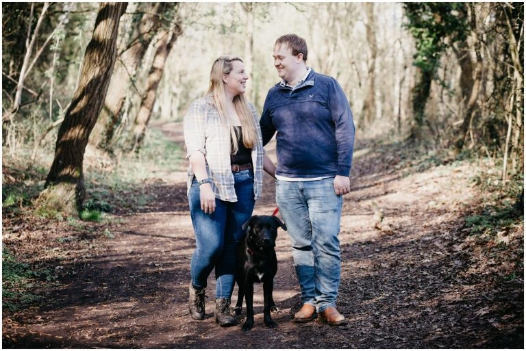 bride and groom to be with dog